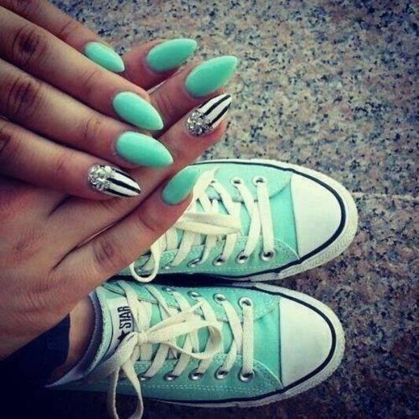 Pastel green nail polish on manicured nails