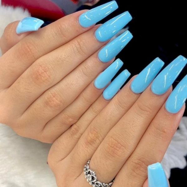 Long nail extensions with cyan nail polish