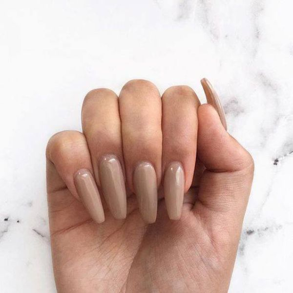Beige color nail extensions