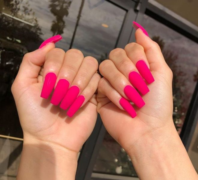 nail extensions with pink nail polish