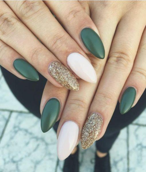 Nail extension with green and white nail art