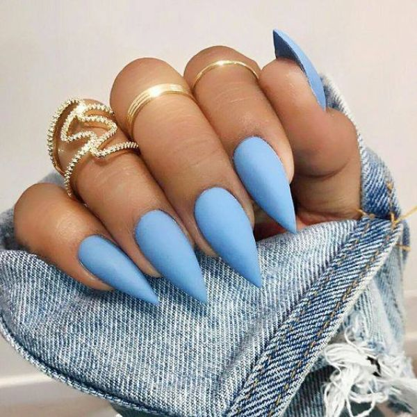 Cyan nail polish on manicured nails
